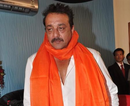 Sanjay with saffron shawl