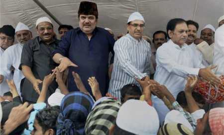 Chauhan with Muslim cap 09-08-2013