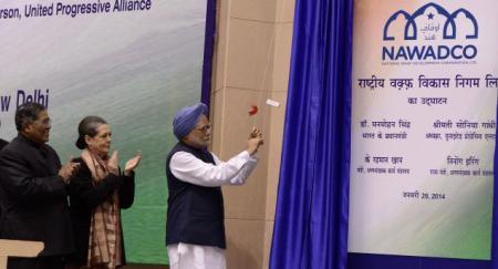 Manmohan Singh with Sonia Gandhi and K. Rahman Khan inauguration of National Waqf Development Corporation in New Delhi on 29-01-2014. Photo-S. Subramanium