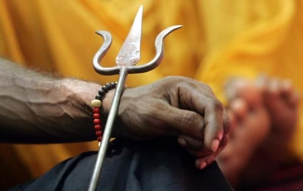 An Indian Hindu sadhu holds a trident during a protest in New Delhi
