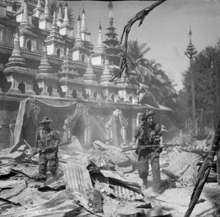 British soldiers on patrol in the ruins of the Burmese town of Bahe during the advance on Mandalay, January 1945