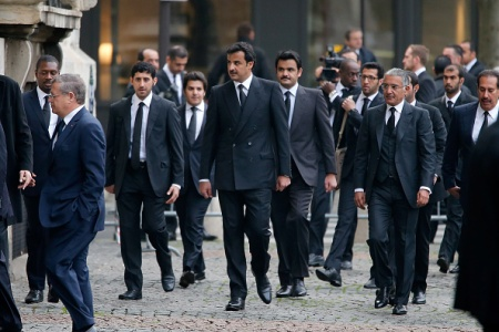 PARIS, FRANCE - OCTOBER 27:  The Heir Apparent of Qatar HH Sheikh Tamim bin Hamad Al Thani  attends the Memorial Service For Christophe De Margerie, Total CEO, at Eglise Saint-Sulpice on October 27, 2014 in Paris, France.  (Photo by Pierre Suu/Getty Images)