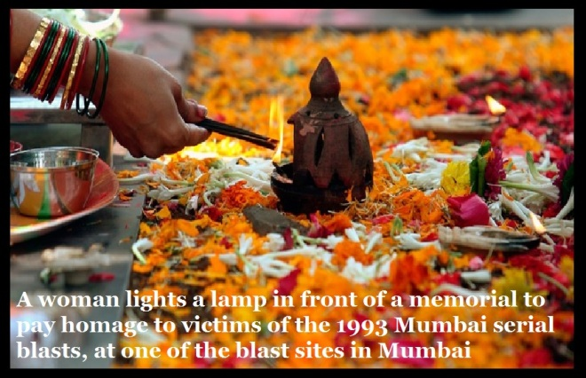 A woman pays homage to victims of the 1993 Mumbai serial blasts, at one of the blast sites in Mumbai