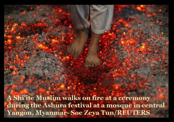 A Shiite Muslim walks on fire at a ceremony during the Ashura festival at a mosque in central Yangon, Myanmar.