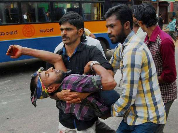 An injured is taken away for medical aid after two groups clashed over -Tipu Sultan Jayanti celebrations, in Kodgu.