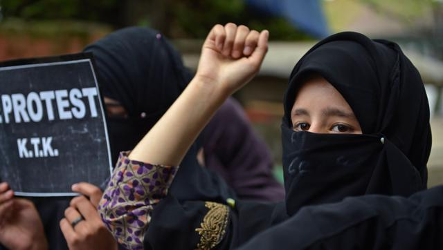 Activists from the Muslim Khawateen Markaz -MKM-take part in a protest in Srinagar over the killing of youth in Handwara-AFP Photo